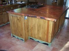 Copper countertops and cheap-ass rustic looking cabnits
