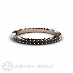 Dramatic natural Black diamonds set this eternity band apart from all others. This band is available in your choice of 14K White, Yellow or Rose Gold.