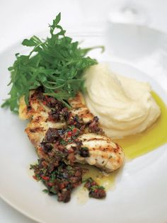This monkfish recipe shows you how to grill or roast this naturally meaty fish so that it is cooked to perfection; great with olive sauce and lemon mash.