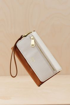 Colorblock of grey, white, and brown make the ultimate neutral wallet for her.