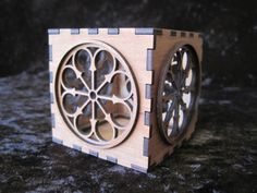 Laser cut tea light candle of St. John's Cathedral rose window in Napier. By Micara