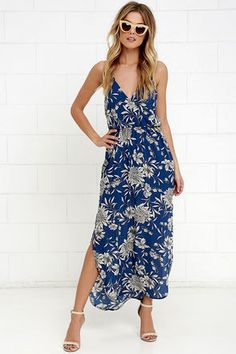 Like a river flowing to the sea, you will naturally gravitate to the Along the Waterway Blue Floral Print Maxi Dress! Blue Georgette with a black and cream floral print adorns a strappy surplice bodice with elasticized waist. Skirt flows to a maxi length with twin side slits. Modified racerback.