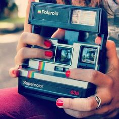 Polaroids are the best things in the world. I want to be able to take pictures of the world around me and remember them forever through Polaroids.