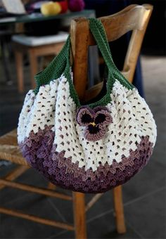 It's a crocheted granny square and the handle color (green in the pic) is what makes it a purse. I love the pansy.