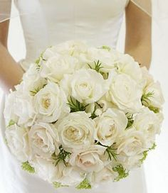 A classic bouquet of white English Roses so simple and beautiful - sprigs of aromatic rosemary have been added as foliage - the rosemary herb is considered to be symbolic of friendship and remembrance - perfectly appropriate for a wedding!
