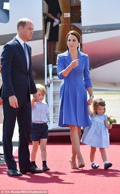 The Duchess leads the way as the family make their way to the terminal