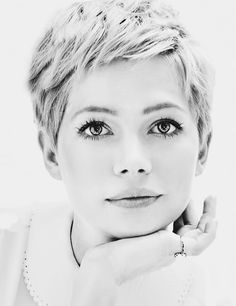 Short Pixie haircut. She's gorgeous!