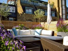 Contemporary roof terrace, Marylebone, London.  Wooden slatted screens and soft purple planting.