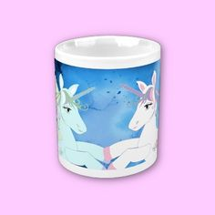 These heavenly pink and blue unicorns are set on a fantasy background of blue ,and a sweet pink love heart has been added for colour contrast.Lovely for a child's first cup or mug when moving on up from a baby bottle or training cup.
