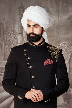Get an emperor look in this lead black color jodhpuri suit fashioned from exclusive  italian fabric giving a soft and matt appeal. The asymmetric coat has its collar and shoulder enhanced with resham and sequins work is teamed with matching color trouser fabric that allows you to tailor in the desired style and size. Wedding Wear, Wedding Suits, Indian Groom Dress, Boys Kurta Design, Asymmetrical Coat, Achkan, Wedding Sherwani, Kurta Designs, Suit Fashion