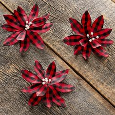 """This set of 3 Poinsettia Christmas ornaments come with an attached clip that easily affixes to your Christmas d?cor. Clip these large artificial flowers on to your holiday garland, wreath, tree, or even on gifts in place of a bow! The Buffalo plaid check pattern on the poinsettia gives it a traditional country farmhouse feel. The center of each flower is accented with white beads. Polyester and metal. 6"""" dia. x 2""""D, each Color: red. Dollar Tree Christmas, Christmas Porch, Plaid Christmas, Rustic Christmas, Bows For Christmas Tree, Christmas Ornaments, Christmas Ideas, Christmas Crafts, Front Door Christmas Decorations"""