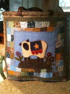 Embellishing a basket with small quilt and wool applique.