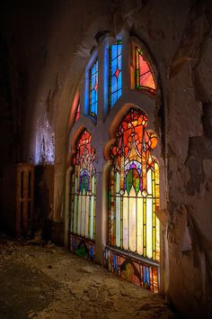 Stained glass windows in ruined building somewhere in Detroit area.