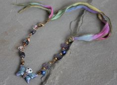 https://flic.kr/p/MPSRq7 | oleander by ruby acorn | oleander by ruby acorn   polymer clay skull butterfly - poison tree  lampwork glass teardrops - unicorne beads  iolite nuggets, rainbow fluorite flowers, brass spacers, antique brass corrugated melons, copper wavy discs, antique brass lobster clasp, antique brass etched jump rings, silk ribbon
