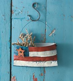 Craft this Patriotic flag accent by decorating a recycled can.