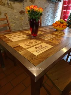Gorgeous dining table with wine panels embedded into it!
