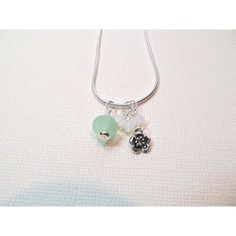 Flower charm necklace silver with lampwork bead and crystals ($29) ❤ liked on Polyvore featuring jewelry, necklaces, silver bead necklace, chain necklace, silver jewelry, dangle charms and silver necklace