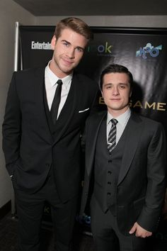 "Liam Hemsworth and Josh Hutcherson arrive at the world premiere of ""The Hunger Games"" in Los Angeles, California."