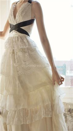 I love the use of the black ribbon on this dress