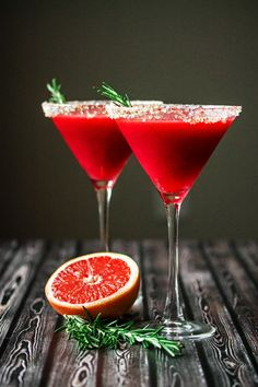 Raspberry Grapefruit & Rosemary Martini with Ginger! An elegant cocktail with a beautiful dark ruby red color, citrusy and sweet, with the just slightly noticeable fragrance and taste of rosemary.