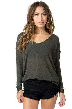 A fall-perfect top featuring a scoop neck and long dolman sleeves. Finished longline hem. Marled knit. Looks amazing with destroyed skinnies and booties. $15.50