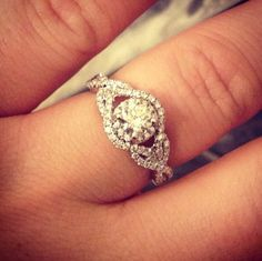 Engagement ring! Gorgeous. I'm getting sick of seeing halo settings, this is a bit more unique. Have to have this.