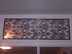 DIY   wrapping paper inside of a picture frame, easy way to decorate an empty wall.