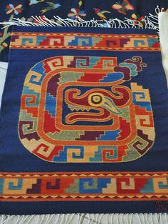 Weaver Bulmaro Perez is known for the rich and vibrant colors of his wool rugs as can be seen in this example.  Teotitlan del Valle, Oaxaca, Mexico