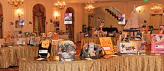 Ideas to improve the silent auction -- plan and set up each table in advance, photograph, box up items, and put photo on (or in) box