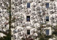 The owners of a bike shop in Germany eschew traditional signage and instead display their wares — 120 bicycles — on a exterior wall of the shop.