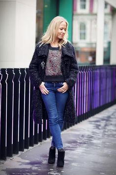 Black wool tweed coat with embellished jumper and ankle boots.