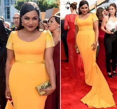 Mindy wore a crystal embellished marigold yellow custom Salvador Perez gown with a train to the Emmys and accessorized with a gold glitter Edie Parker 'Mindy' clutch!