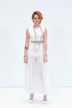 Pin for Later: Kristen Stewart's Red Carpet Evolution Proves She's a Total Fashion Girl  Kristen rocked the sheer pants trend for the Chanel Couture show in Paris in 2014.