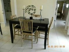 In the process if removing the black from the table & chairs