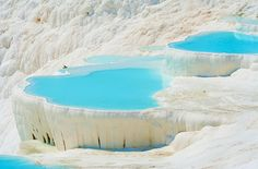 """Turns out that world is ours, and that place is Turkey's Pamukkale, or """"cotton palace."""" A dazzling sight since ancient times, turquoise water fills dozens of terraced semicircular travertine pools. The fresh deposits of calcium carbonate give the warm-water basins their vivid white sheen."""