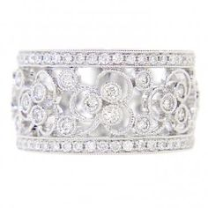 I\'m a sucker for wide diamond wedding bands with intricate, feminine ...