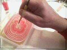 Video on how to easily make small original marbled papers. This intro shows how to make them, then lay them out for reproduction.