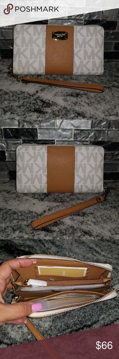 🎉🎊 Michael Kors Center Stripe 🎊🎉 Authentic Michael Kors wallet wristlet with detachable strap. Jet Set Coin Multi Function Phone Case. Very spacious! 👌 Comes in Vanilla and Acorn colors. Was purchased as gift for niece but she already has this color. Brand new with tags! Michael Kors Bags Wallets