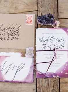 Boho wedding invitations: gold leaf, dipped purple edges, and calligraphy by Foil & Ink