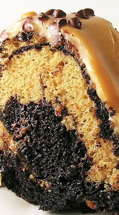 Caramel Turtle Bundt Cake ~ Swirls of caramel and chocolate cake, topped with caramel sauce and pecans, make this a beautiful and decadent dessert!