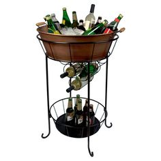 Ice bin with an antique copper finish on a stand featuring a 9-bottle wine rack.       Product: Party tub and standCo...