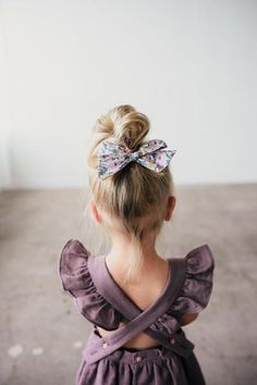 Click to shop these big and mini pinwheel hair bows available in large and mini versions! Perfect for you baby, toddler or little girls free spirit and adventurous style. Handcrafted in the USA and guaranteed for life!! Dress by Blythe and Reese