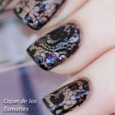 Black lace and studs nail art