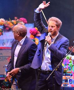Prince Harry led the crowd in a giant sing-song tonight at the Coldplay concert at his hom...