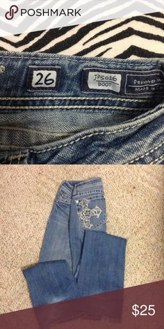 Light wash Miss Me jeans Miss Me boot cut jeans with Cross on back pockets. Bottoms are ragged. Miss Me Jeans Boot Cut