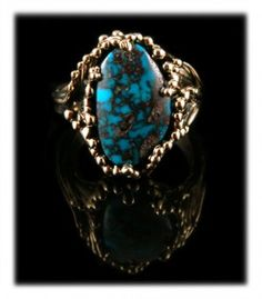 Bisbee Turquoise and Gold Ring for Ladies by Crystal Hartman. Beautiful 14k yellow gold leaves wrap up to caress a top gem grade natural Bisbee Turquoise cabochon from Arizona.