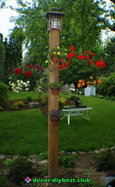 pole for shade sail: Sturdy out door plant hanger and easy to make. cedar post 3 15 inch hangers lag boltedd in. 3 round pot hangers for the front decorative topper. Garden Posts, Lawn And Garden, Garden Art, Outdoor Projects, Garden Projects, Outdoor Plants, Outdoor Gardens, Cedar Posts, Front Yard Landscaping