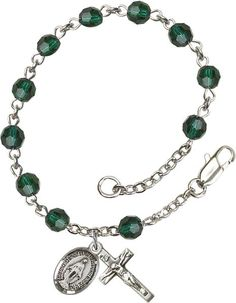 Sterling Silver Rosary Bracelet features 5mm Emerald Swarovski beads. The Crucifix measures 5/8 x 1/4. Each Rosary Bracelet is presented in a deluxe velvet gift