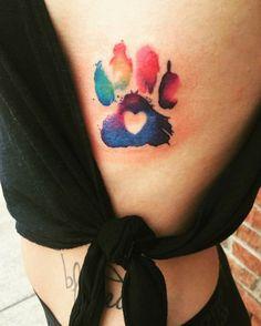Colorful dog paw tattoo