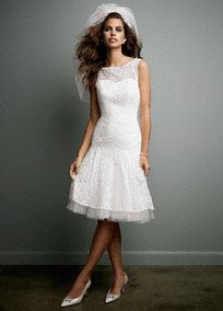 Classically elegant with a modern twist, this short all over lace number will leave you speechless!  Tank bodice features stunning illusion lace neckline and eye-catchingkey-hole back detail.  All over lace detail and tulle hem underlay make this dress trulychic and understated.  Sizes 0-14. Soft White available in stores and online. White available by Special Order in stores.  Woman: Style 9WG3625. Sizes 16W-26W.  (Special Order Only).  Fully lined. Back zip. Imported polyester. Dry clean. To preserve your wedding dreams, try our Wedding Gown Preservation Kit.